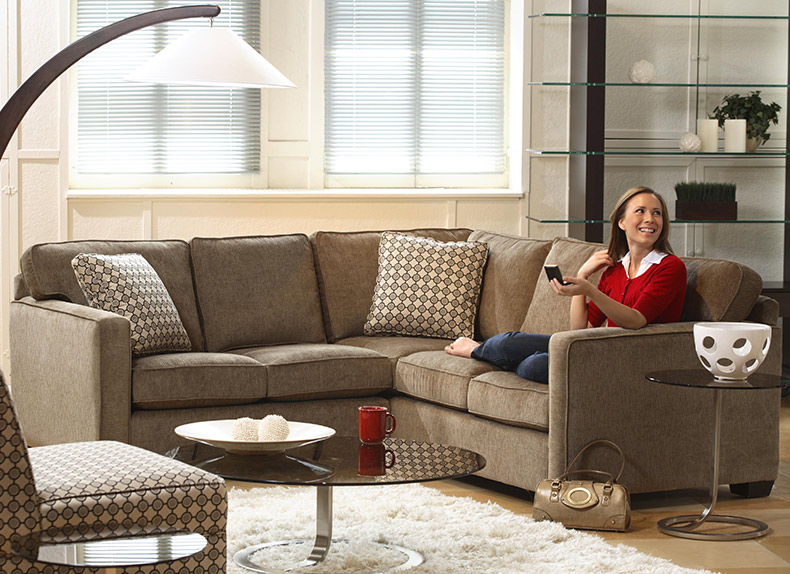 Happy Woman on Sectional Sofa