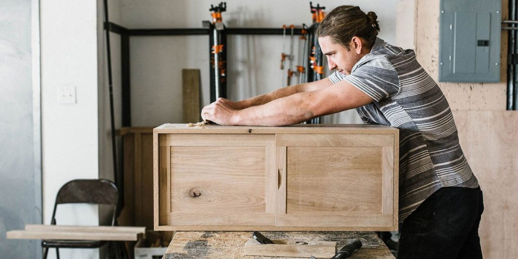 Man Woodworking Building Table